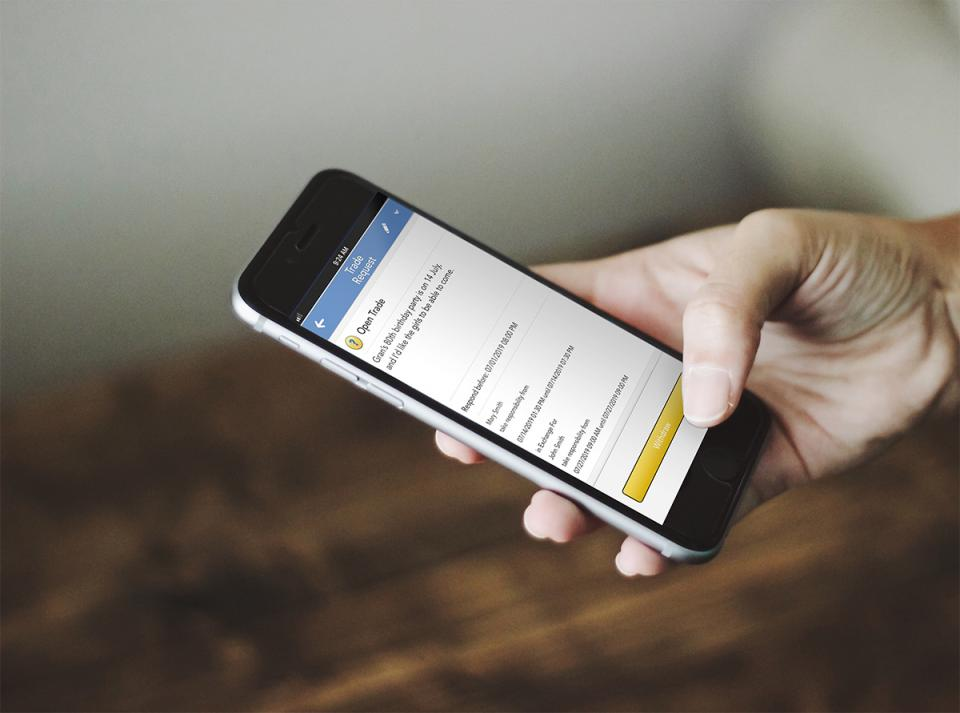 A parent reviews an open trade request via the OFW app.